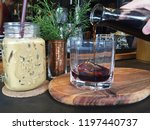 pouring black coffee on ice... | Shutterstock . vector #1197440737