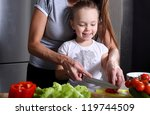 mother helping her daughter... | Shutterstock . vector #119744509