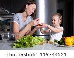 mother helping her daughter... | Shutterstock . vector #119744521