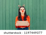 christmas delivery girl holding ... | Shutterstock . vector #1197449377