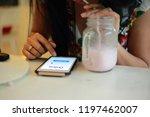 hand woman using smartphone in... | Shutterstock . vector #1197462007