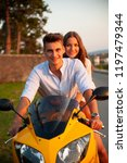young couple on a motor bike on ... | Shutterstock . vector #1197479344