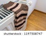 warm woolen socks on the heater.... | Shutterstock . vector #1197508747