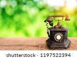 retro telephone on wooden with... | Shutterstock . vector #1197522394