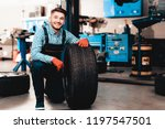 young smiling mechanic holds a... | Shutterstock . vector #1197547501