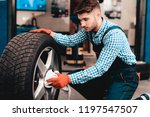 young smiling mechanic cleans a ... | Shutterstock . vector #1197547507