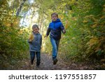 two happy european boys run... | Shutterstock . vector #1197551857