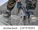 close up worker cutting metal... | Shutterstock . vector #1197570391