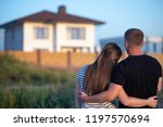 couple looking at they's house | Shutterstock . vector #1197570694