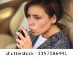 young millennial woman using... | Shutterstock . vector #1197586441