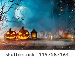 halloween pumpkins on old... | Shutterstock . vector #1197587164