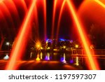 colorful fountains in city park ... | Shutterstock . vector #1197597307