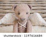 a teddy bear with angel wings...