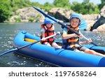 Little Children Kayaking On...