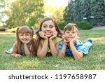 mother with her cute children... | Shutterstock . vector #1197658987