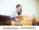 young asian business owner... | Shutterstock . vector #1197693991