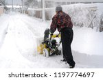 man operating snow blower to... | Shutterstock . vector #1197774697