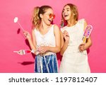 two young stylish smiling blond ... | Shutterstock . vector #1197812407