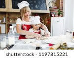 preparing cookies. mom and... | Shutterstock . vector #1197815221