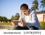 surprised young man with a... | Shutterstock . vector #1197835951