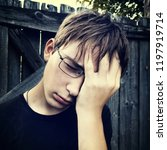 toned photo of sad teenager on... | Shutterstock . vector #1197919714