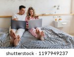young attractive couple sitting ... | Shutterstock . vector #1197949237