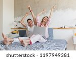 young couple having fun on bed... | Shutterstock . vector #1197949381