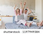 young couple having fun on bed... | Shutterstock . vector #1197949384