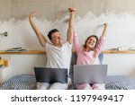 young couple on bed in morning  ... | Shutterstock . vector #1197949417
