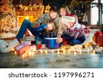 family playing with gifts on... | Shutterstock . vector #1197996271