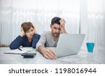 worried couple paying bills... | Shutterstock . vector #1198016944
