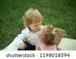 sister kiss brother with blond... | Shutterstock . vector #1198018594
