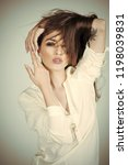 sensual woman in white shirt ...   Shutterstock . vector #1198039831