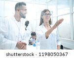man and woman in white lab coats | Shutterstock . vector #1198050367