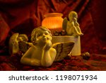 several porcelain angels and a... | Shutterstock . vector #1198071934