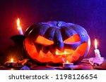 halloween. glowing pumpkin in... | Shutterstock . vector #1198126654