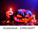 halloween. glowing pumpkin in... | Shutterstock . vector #1198126657