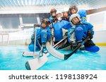 junior hockey team with goalie... | Shutterstock . vector #1198138924