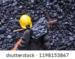 Hand Of The Miner Shows Coal...