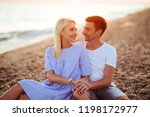 young happy couple on seashore... | Shutterstock . vector #1198172977