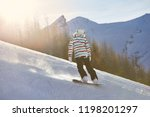 snowboarding in the alps ...   Shutterstock . vector #1198201297