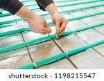 underfloor heating installation ... | Shutterstock . vector #1198215547