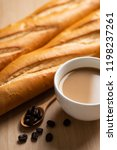 cup of coffee and baguette... | Shutterstock . vector #1198237261