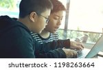 happy asian boy typing  on... | Shutterstock . vector #1198263664
