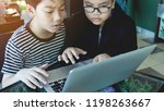 happy asian boy typing  on... | Shutterstock . vector #1198263667
