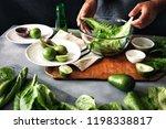 man cooking green detox salad... | Shutterstock . vector #1198338817