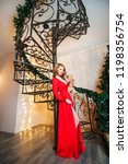 the girl in the red long dress...   Shutterstock . vector #1198356754
