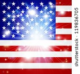 Flag of America background with pyrotechnic or light burst and copy space in the centre - stock photo