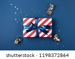 gift box wrapped in red striped ...   Shutterstock . vector #1198372864