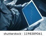 a man working on digital tablet ... | Shutterstock . vector #1198389061